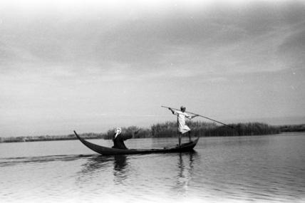 Shaghanba men spear fishing