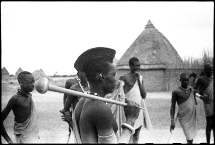Shilluk man with a wooden club