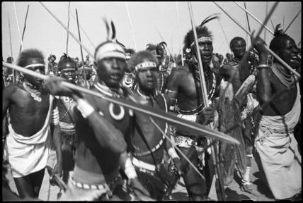 Dinka men at a funeral dance