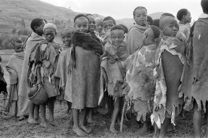 Boys wearing goatskins