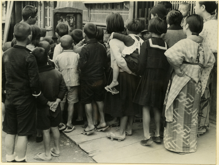 Children watching puppet show