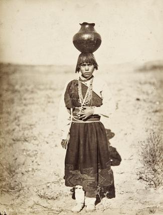 Pabla Tafolla carrying a pottery vessel