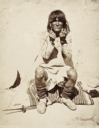 Hopi man spinning yarn