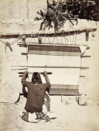 Hopi man weaving a sacred blanket