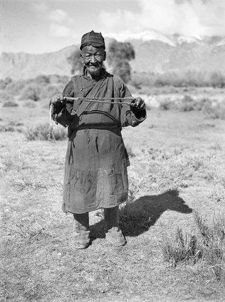 Tibetan shepherd with sling