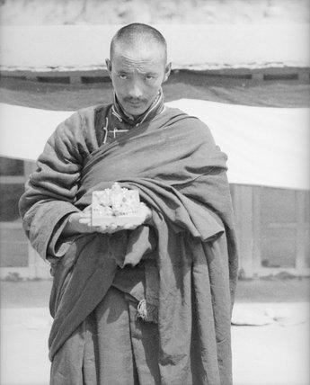 Monk holding the seal of Tsurphu
