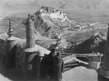 Monks blowing radung, Potala in distance