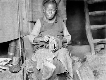Tibetan cobbler in Lhasa