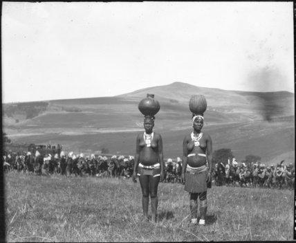 Zulu women carrying beer vessels