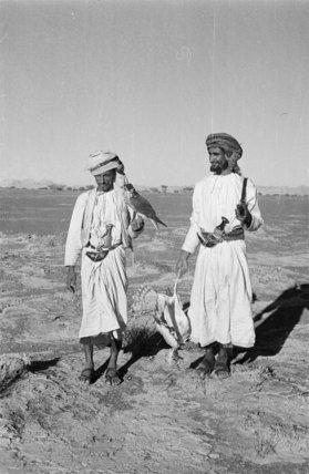 Standing portrait of two falconers ...