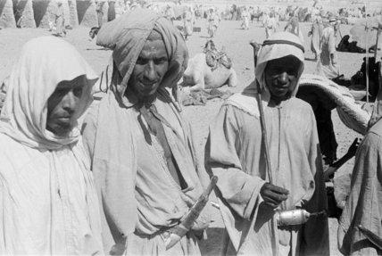 Group portrait of three Arab ...