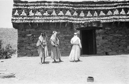 View of three men standing ...