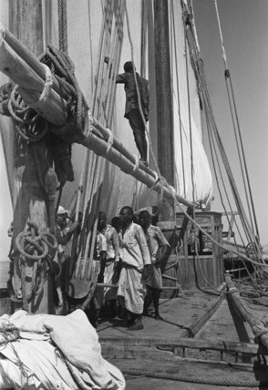 View of sailors hoisting sails ...
