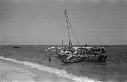 View of men unloading dhows ...