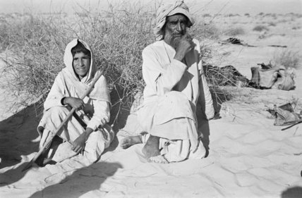 Seated portrait of two tribesmen ...