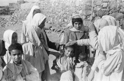 Group portrait of Arab teenaged ...