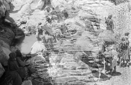 Mahra Bedouin filling water skins ...