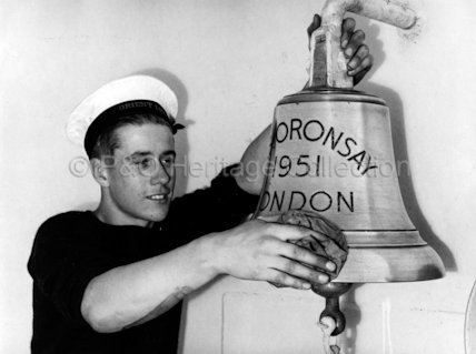 Cleaning the ship's bell on board ORONSAY