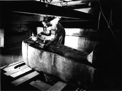 Howard Carter working on the lid of the middle coffin