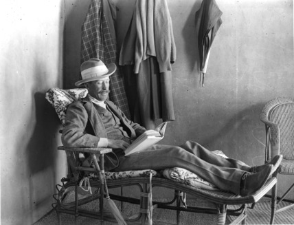 Lord Carnarvon reading on the verandah of 'Castle Carter'