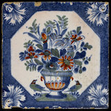 English Delftware tile with an urn of flowers