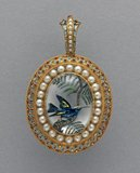 Pendant with a bird set with pearls, by W.J. Thomas
