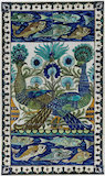 Tile panel with blue peacocks, by William De Morgan