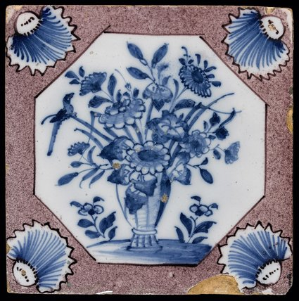 Earthenware tile with a tall vase of flowers