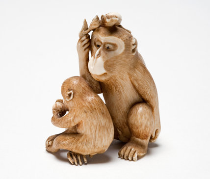 Netsuke of an adult male monkey and its young