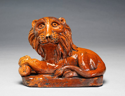 Pill Pottery Recumbent Lion, by H. Davies