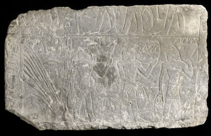 Carved limestone relief with wine making scenes