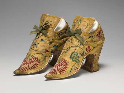 English silk shoes, bound with ribbon and embroidered