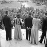 An ENSA concert party entertaining troops from the steps of a chateau in Normandy, 26 July 1944.