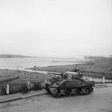 A Sherman command tank of 13th/18th Hussars, 8th Armoured Brigade, near the River Waal at Nijmegen, 15 October 1944.