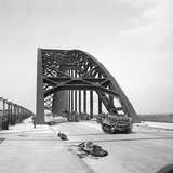Universal carriers and lorries crossing the bridge at Nijmegen in Holland during Operation 'Market Garden', 21 September 1944.