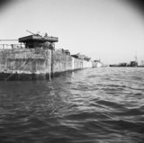 A line of Phoenix caisson units, part of the 'Mulberry' artificial harbour at Arromanches, 12 June 1944.
