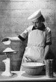 A Cecil Beaton portrait of a cook in the Women's Royal Naval Service.