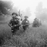Led by their piper, men of 7th Seaforth Highlanders, 15th (Scottish) Division advance during Operation 'Epsom' in Normandy, 26 June 1944.
