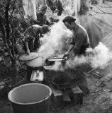 Royal Artillery cooks preparing Christmas dinner near Geilenkirchen, Germany, 25 December 1944.