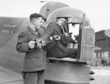 Armourers install .303 Browning machine guns into the rear turret an Armstrong Whitley Mk V of No. 58 Squadron RAF at Linton-on-Ouse, Yorkshire, June 1940.