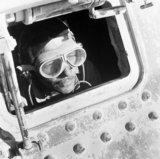 Cecil Beaton portrait of a British tank driver peering out of his Grant tank in North Africa, 1942.