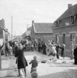 The inhabitants of Eau Rouge in Belgium greet Allied troops, 4 September 1944.