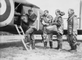 The crew of an Armstrong Whitworth Whitley bomber of No. 58 Squadron RAF load their parachutes on board their aircraft at Linton-on-Ouse, Yorkshire, prior to a sortie, June 1940.