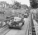 Field Marshal Montgomery stands up in his Humber staff car as he crosses the River Seine at Vernon, 1 September 1944.