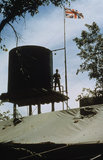 The Union Flag flies over Assembly Area Alpha in north east Rhodesia during the seven day ceasefire at the start of the peace process, January 1980.