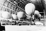 Kite balloons of No. 1 Balloon Training Unit await their handlers, during the morning parade in No. 1 Airship Shed at Cardington, October 1940.