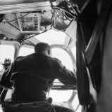 The navigator at work in a Lockheed Hudson of No. 269 Squadron flying an 'ice patrol' over the Denmark Strait between Iceland and Greenland, May 1942.