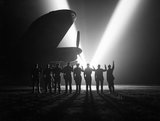 Ground staff at an RAF bomber station in Britain celebrate VE Day, 8 May 1945.