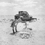 A British soldier inspects the grave of a German tank crewman, killed when his PzKpfw III tank was knocked out in the Western Desert, 29 September 1942.