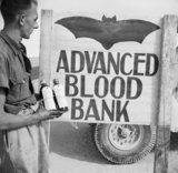 A 'Vampire' sign outside an Army Blood Transfusion Service advanced blood bank in the Western Desert, 29 October 1942.
